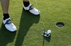 Golf Putt. A man making a Golf Putt a sunny day Stock Image