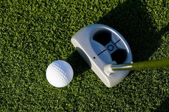 Golf Putt. A short put in the game of golf with a ball and a putter Stock Images