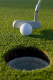 Golf Putt. A short put in the game of golf with a ball and a putter Stock Photography