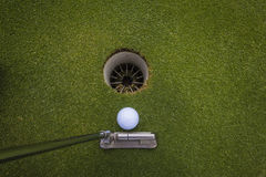 Golf Putt Ball Hole. Players View of knocking the golf ball into the hole Stock Photos