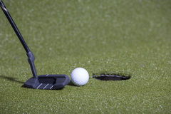 Golf putt on a green field Royalty Free Stock Photos