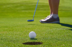 Golf putt green. Golfer hitting driver off tee box Royalty Free Stock Photo