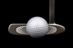 Golf Putter and Golf Ball on a Black Background Royalty Free Stock Photography