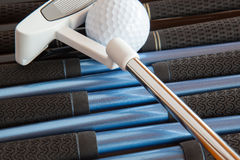 Golf putter and golf clubs Stock Images