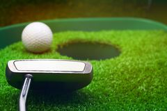 Golf and  with putter on green background Stock Photos