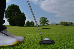 Golf putter hole Stock Images