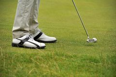 Golf putting from the fringe Royalty Free Stock Photography