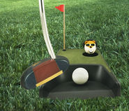 Golf(Putting Practice). Golf putting practice device captured on the grass with putter royalty free stock photography