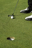 Golf putting stroke Stock Photos