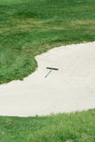 Golf rake in a sand trap Royalty Free Stock Image