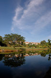 Golf Resort. Golfer surrounded by beautifull landscaped Stock Photo