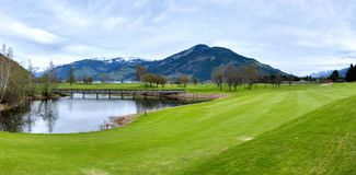 Golf resort with mountains Royalty Free Stock Image