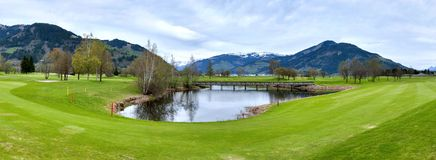 Golf resort with mountains Stock Photography