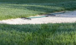 Golf sand bunker on pathway side in a court in palma de mallorca. Sand bunker Ball in a golf court in the spanish island of mallorca Royalty Free Stock Images