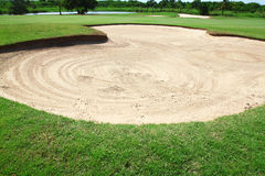 Golf: sand trap on the green grass Royalty Free Stock Images