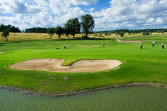 Golf sand traps. Sand bunkers and a pond on a golf course Stock Image
