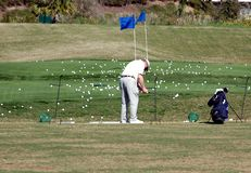 Golf School. Photographed elder man practicing golf at a local golf school in Florida Royalty Free Stock Photography