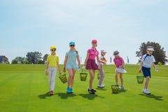 Golf school. Kids warming up at golf school at summer day Stock Photo