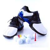 Golf-Schuhe und Kugeln Stockfotografie