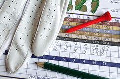Golf Score Card with Glove, Pencil, & Tee Stock Images