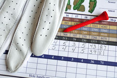 Golf Score Card with Glove and Red Tee Royalty Free Stock Photos