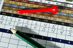 Golf Score Card with Red Tee and Green Pencil Stock Photo