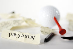 Golf score card teared apart. With peg through ball, due to bad result Stock Images