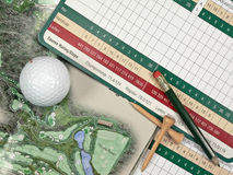 Golf Scorecards. A golfer's scorecard, pencil, tees, ball, and course book Stock Images