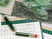 Golf Scorecards. A golfer's scorecard, pencil, tees, ball, and course book Royalty Free Stock Photo