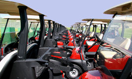 Golf season. Golf carts in lines awaiting Stock Images