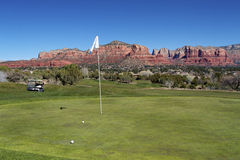 Golf in Sedona. A scenic sedona arizona golf green with red rock backdrop Stock Photography