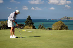Golf - setzend Stockbild