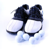 Golf Shoes and Balls Stock Image
