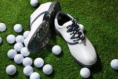 Golf shoes and balls Stock Photography