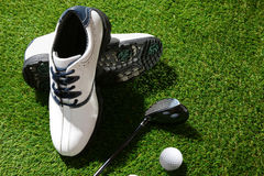 Golf shoes,club and ball Royalty Free Stock Photography