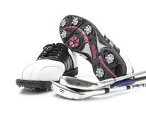 Golf shoes with clubs Royalty Free Stock Image