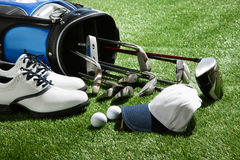 Golf shoes,hat,balls and clubs in bag Stock Images