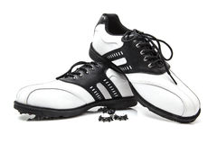 Golf shoes with spare spikes Stock Photos