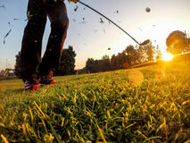 Golf: Short Game around the green. Golf: example of short game using a wedge iron club. Close-up, low angle view, sunset Stock Photo