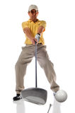 Golf Shot at Impact. Golfer at the moment of impact with selective depth of field stock photos