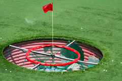 Golf Shot. Large golf driving range practice hole with flag Stock Image