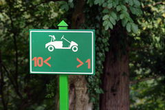 Golf sign. Golf cart sign on the golf course Royalty Free Stock Image