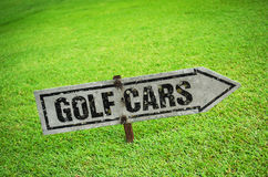 Golf sign. Rusty golf cart sign on green Stock Photography