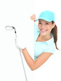 Golf sign - woman showing paper billboard. Golf sign - female golf player showing white paper sign holding golf club. Beautiful smiling Asian Caucasian woman Royalty Free Stock Photo