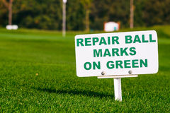 Golf signs on grass Royalty Free Stock Image