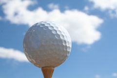 Golf in the sky. Golf ball and sky royalty free stock photos