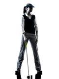 Golf spielendes Schattenbild des Frauengolfspielers Lizenzfreies Stockfoto