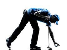 Golf spielendes Schattenbild des Manngolfspielers Stockfoto