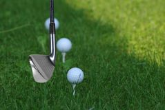 Golf stick and ball Stock Photo