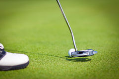Golf Stick and Ball on the Green Grass Stock Photo